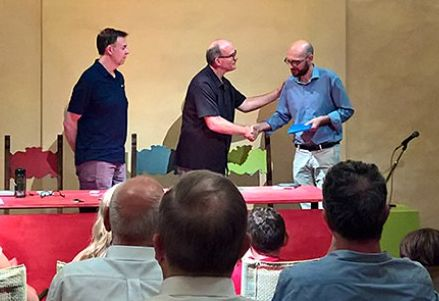 Larry Snyder presents his book Miracles in Montanare to Dr. Albano Ricci (of the Cortona City Council) at special ceremony in Cortona, Italy on July 3rd.